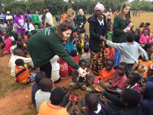 pupils giving out gifts donated by people in scotland to the mary martha rehabilitation and orphan care centre